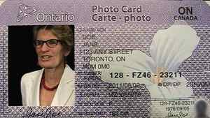 Ontario Transportation Minister Kathleen Wynne poses in a template for a new Ontario photo identification card at the legislature in Toronto, Thursday, June 9, 2011.