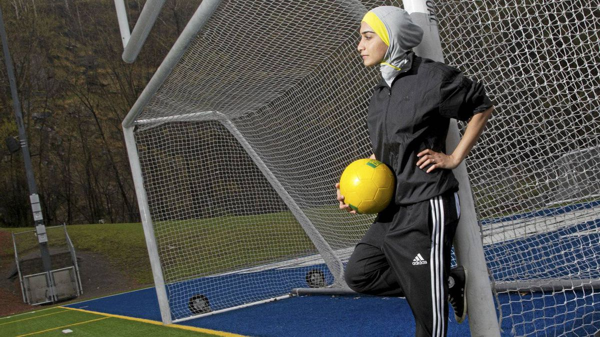Elham Seyed Javad wears her design for a sports hijab in Montreal, May 1, 2012. Her design is in competition to become the headscarf chosen by FIFA, which is lifting its ban on the head coverings in soccer.