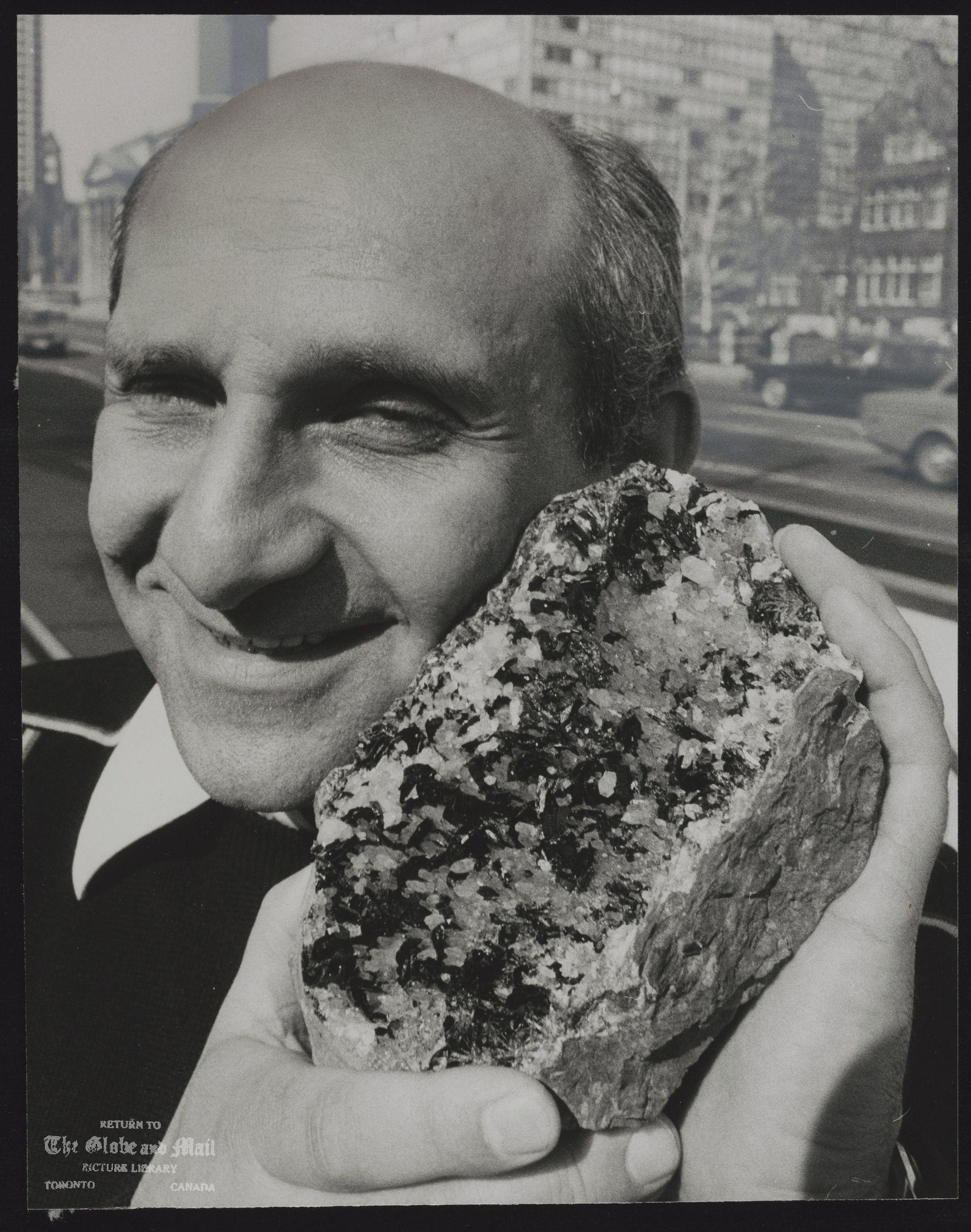 KULANITE B. Darko Sturman holds large piece of Kulanite, one of new minerals found in Yukon.