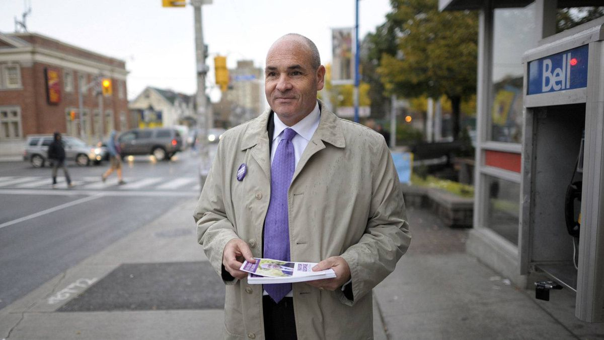 Toronto mayoral candidate George Smitherman is photographed meeting and greeting people while campaigning at the corner of Dufferin St. and Bloor S.t West on Oct 5 2010. Smitherman is using an rv dur a 44 wards in four days blitz.