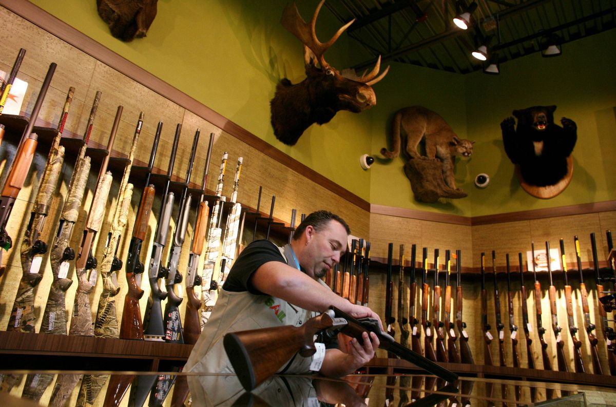 Sales person Martin Morissette in the gun section of Sail's Ottawa outlet. This wall of 200 guns is upstairs, out of sight from the main level.