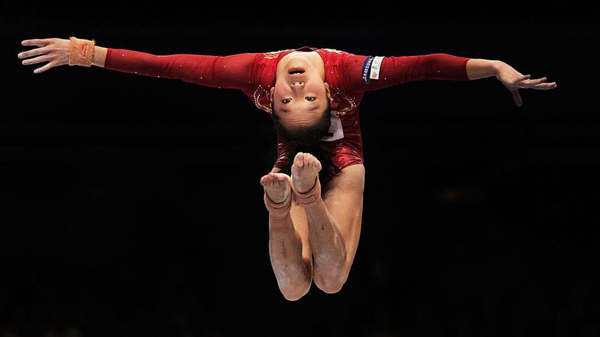 Yao Jinnan of China competes on the balance beam during the women's all around final.