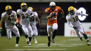 B.C. Lions' Andrew Harris, centre, outruns Edmonton Eskimos' J.C. Sherritt, from left, Julius Williams and Donovan Alexander for a 63-yard-touchdown during the second half of a CFL football game in Vancouver, B.C., on Friday Sept. 30, 2011.