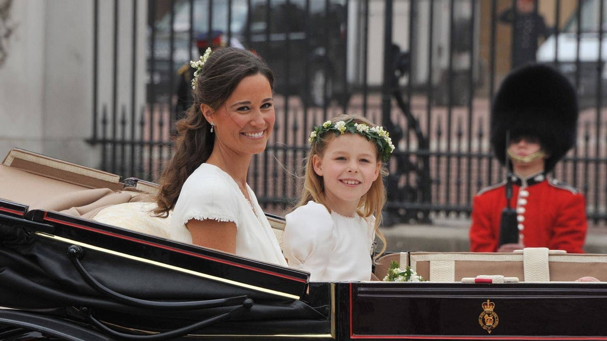 Philippa Middleton, sister of Kate, Duchess of Cambridge, and the Maid of Honour travels with a bridesmaid in an Ascot Landau carriage along the Processional Route to Buckingham Palace, in London, on April 29, 2011.