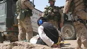 Soldiers supervise a detainee during Operation Medusa in the Panjwaii district of Kandahar Province, Afghanistan.