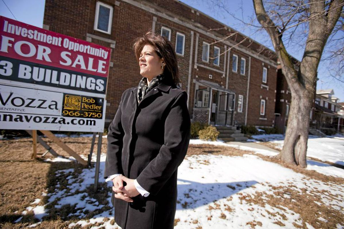 Anna Vozza, President of the Windsor/Essex Real Esate Board stands in front of an investment property consisting of 3 buildings close to downtown Windsor, February 18, 2010. The 3 properties have an asking price of $600,000.