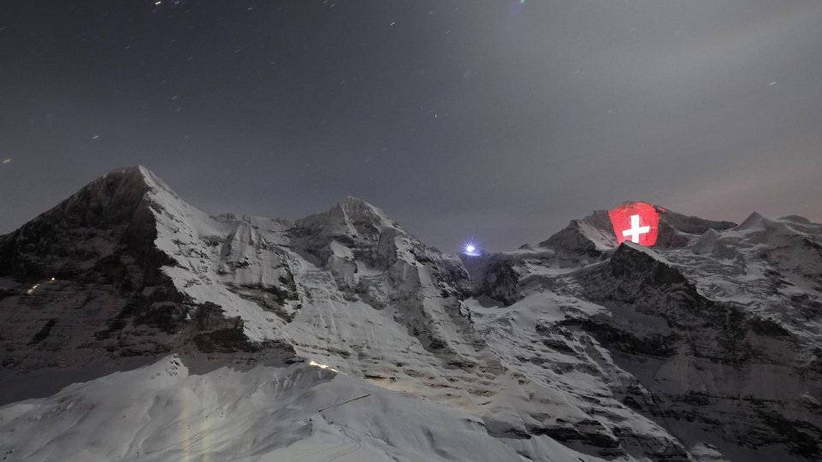 A giant light installation of the Switzerland flag, by Swiss artist Gerry Hofstetter, illuminates the north face of the Jungfrau mountain in the Bernese Oberland, January 1, 2012.