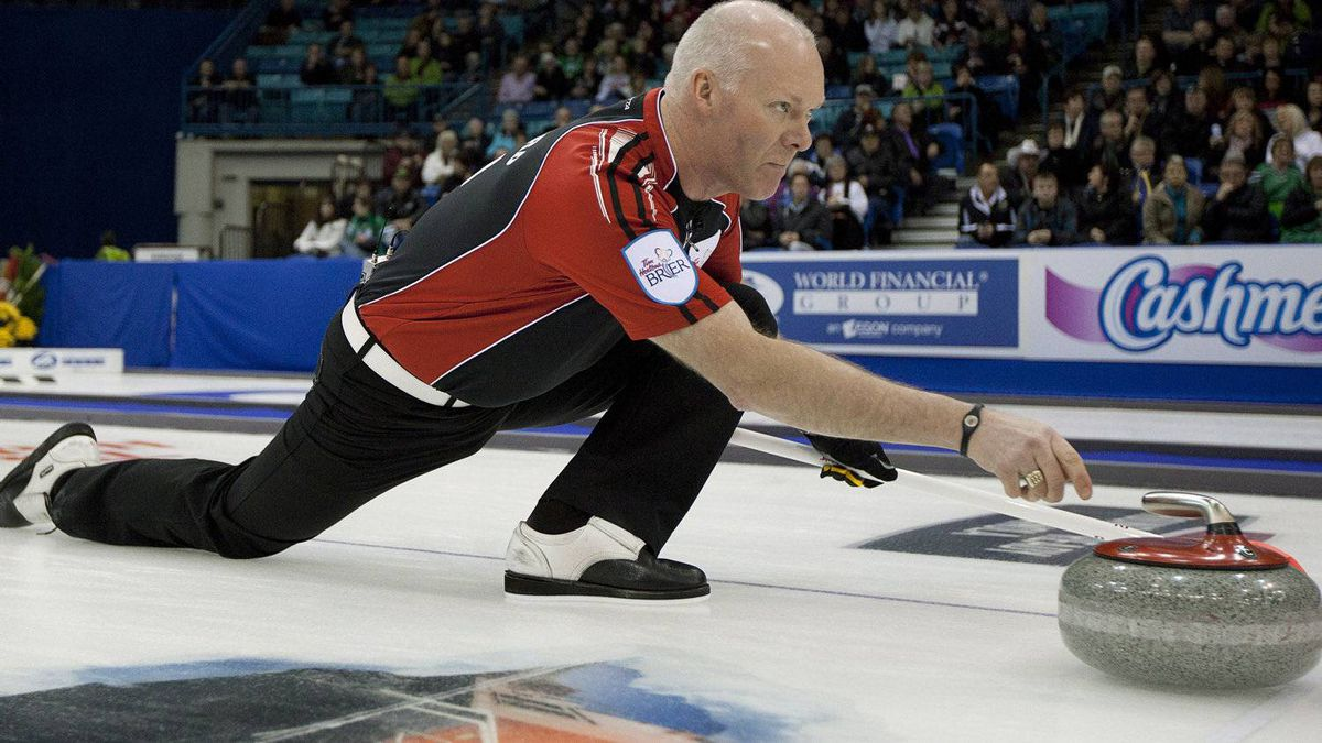 Team Ontario skip Glenn Howard, centre, makes a shot during an afternoon draw against New Brunswick at the Tim Hortons Brier in Saskatoon, Saturday, March, 3, 2012. THE CANADIAN PRESS/Jonathan Hayward