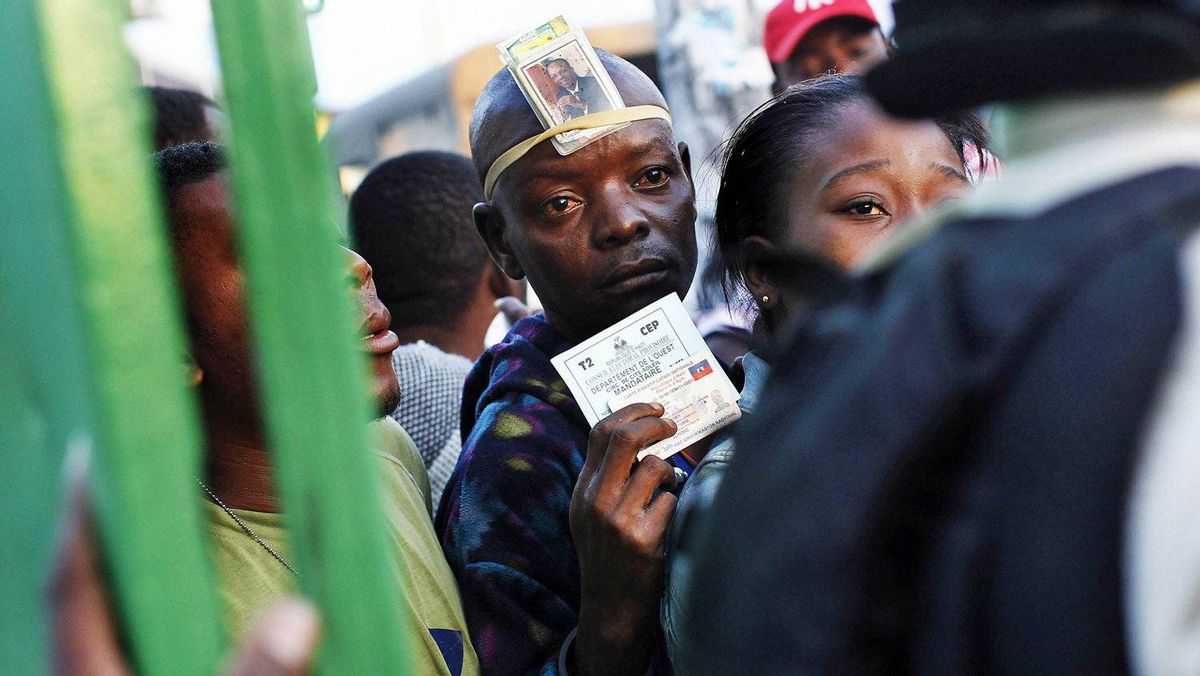 A man waits to enter a polling station in Cite Soleil, a slum in Port-au-Prince, during Haiti's presidential run-off election on March 20, 2011.