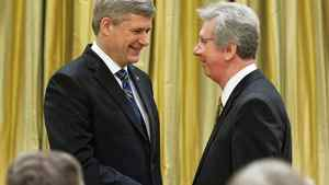 Jean-Pierre Blackburn shakes hands with Prime Minister Stephen Harper after being sworn in as Veterans Affairs Minister at Rideau Hall on Jan. 19, 2010.
