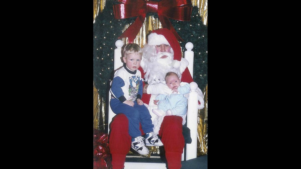 Diane Porter photo: Remember Santa, No choking the baby - I think this Santa missed the class on how to hold a baby. He also doesn't look very Jolly. This was taken in Calgary in 1990. Ryan Porter is 3yrs old and his sister Erin is 2 months.