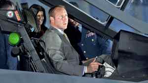 Defence Minister Peter MacKay checks out the cockpit of a F-35 Joint Strike Fighter mockup in Ottawa on July 16, 2010.