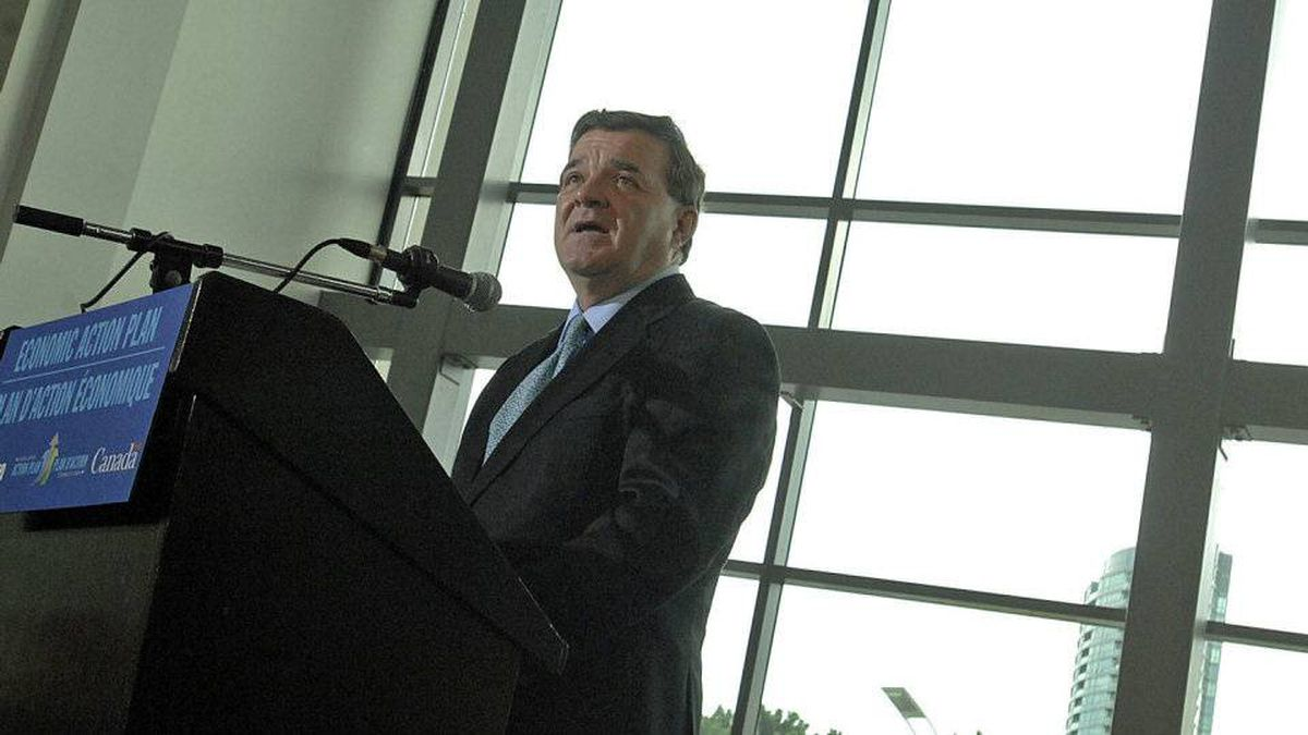Finance Minister Jim Flaherty speaks at the Direct Energy Building in Toronto, which will house a replica of a lake for reporters at the G20 summit this month.