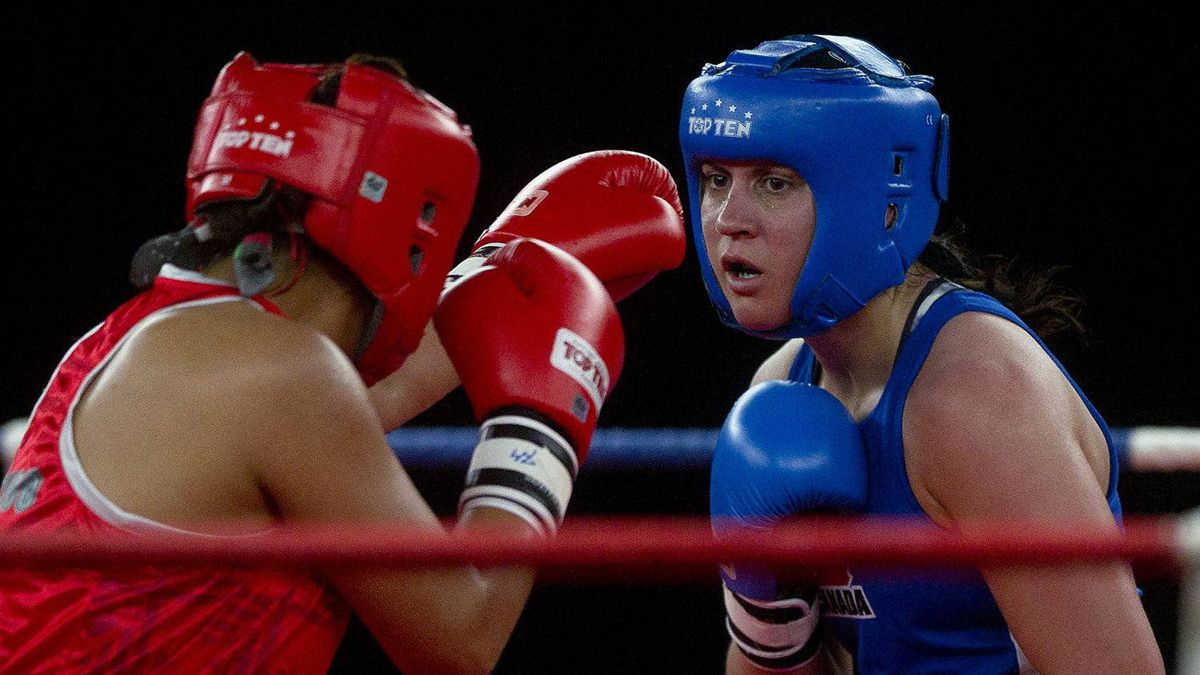 Canadian boxer Mary Spencer (blue) and Mexican boxer Alma Nora Ibarra (red) compete at the Women's Elite Continental Championships in Cornwall, Ont. Wednesday, April 4/2012.