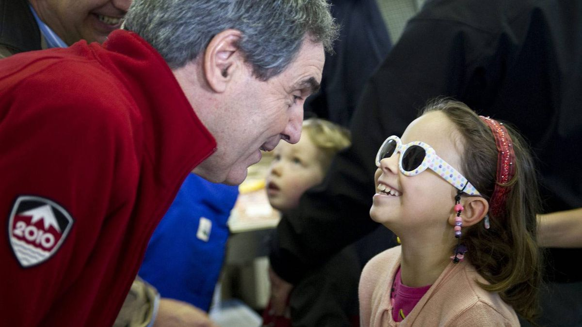 A young girl shows off her sunglasses to Liberal Leader Michael Ignatieff at a market Saturday, April 30, 2011 in Guelph, Ont.