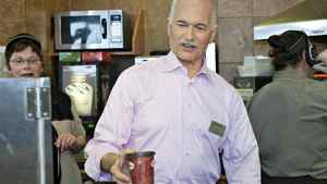 NDP Leader Jack Layton serves a coffee at a Tim Hortons in Welland, Ont., on April 19, 2011.