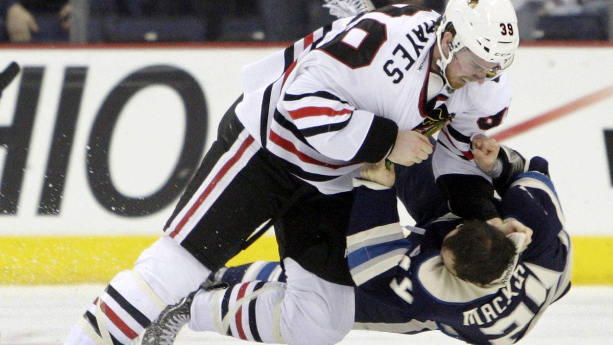 Chicago Blackhawks' Jimmy Hayes, left, and Columbus Blue Jackets' Derek MacKenzie fight during the second period of an NHL hockey game, Saturday, Feb. 18, 2012, in Columbus, Ohio. The Blackhawks won 6-1. (AP Photo/Jay LaPrete)