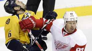 Detroit Red Wings right wing Johan Franzen (93), of Sweden, collides with Nashville Predators defenseman Shea Weber (6) in the first period of Game 1 on Wednesday, April 11, 2012, in Nashville, Tenn. Franzen was called for roughing on the play. Weber would later punch Wings forward Henrik Zetterberg into the glass near the end of the game. Nashville won 3-2.