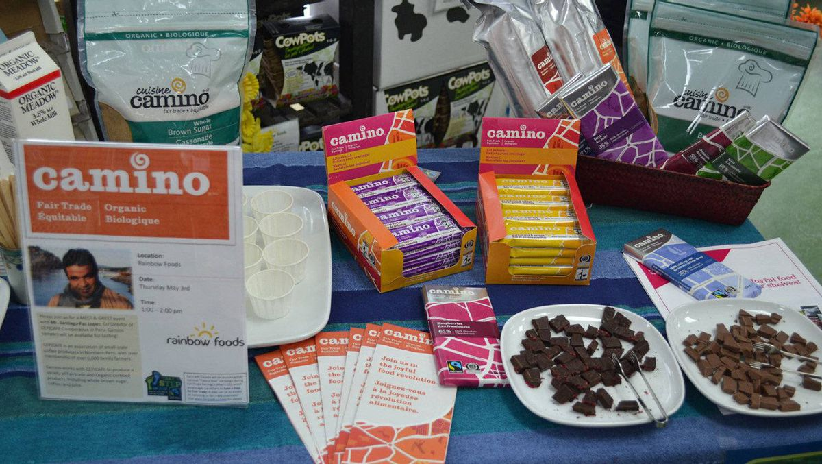 Camino products on display at a retail store. Along with chocolate bars, the fair trade and organic Camino line also includes coffee, juice, baking products and hot chocolate. La Siembra sources raw materials for all of its Camino line of products from 18 co-ops in 10 different countries. Thousands of family farmers are members of these co-ops. .