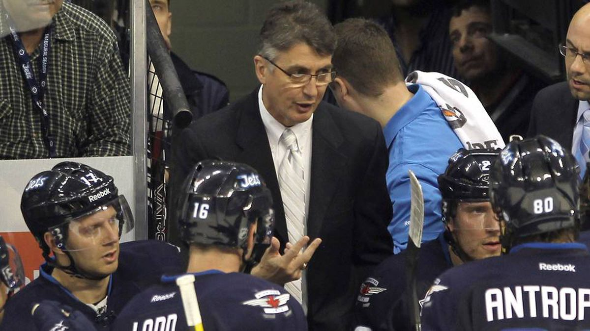 Head coach Claude Noel takes a timeout in the second period during the game against the Ottawa Senators at the MTS Centre on November 29, 2011 in Winnipeg.