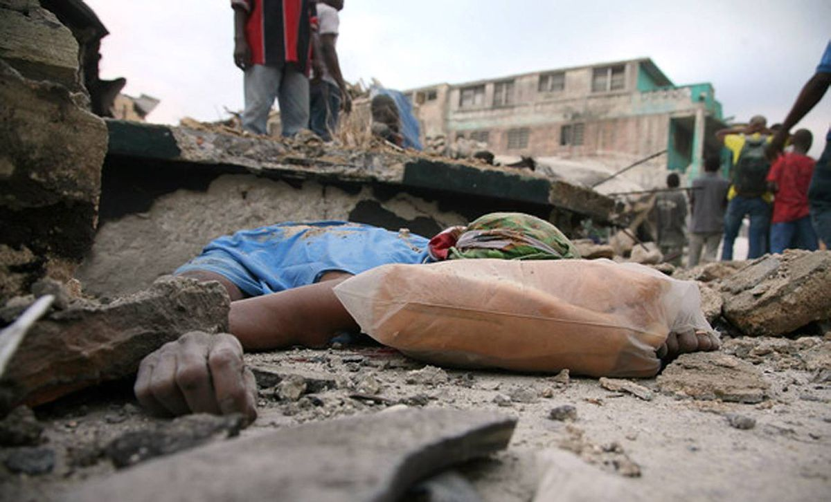 A body lies amid rubble on January 12, 2010 in Port-au-Prince after a huge earthquake measuring 7.0 rocked the impoverished Caribbean nation of Haiti, toppling buildings and causing widespread damage and panic.