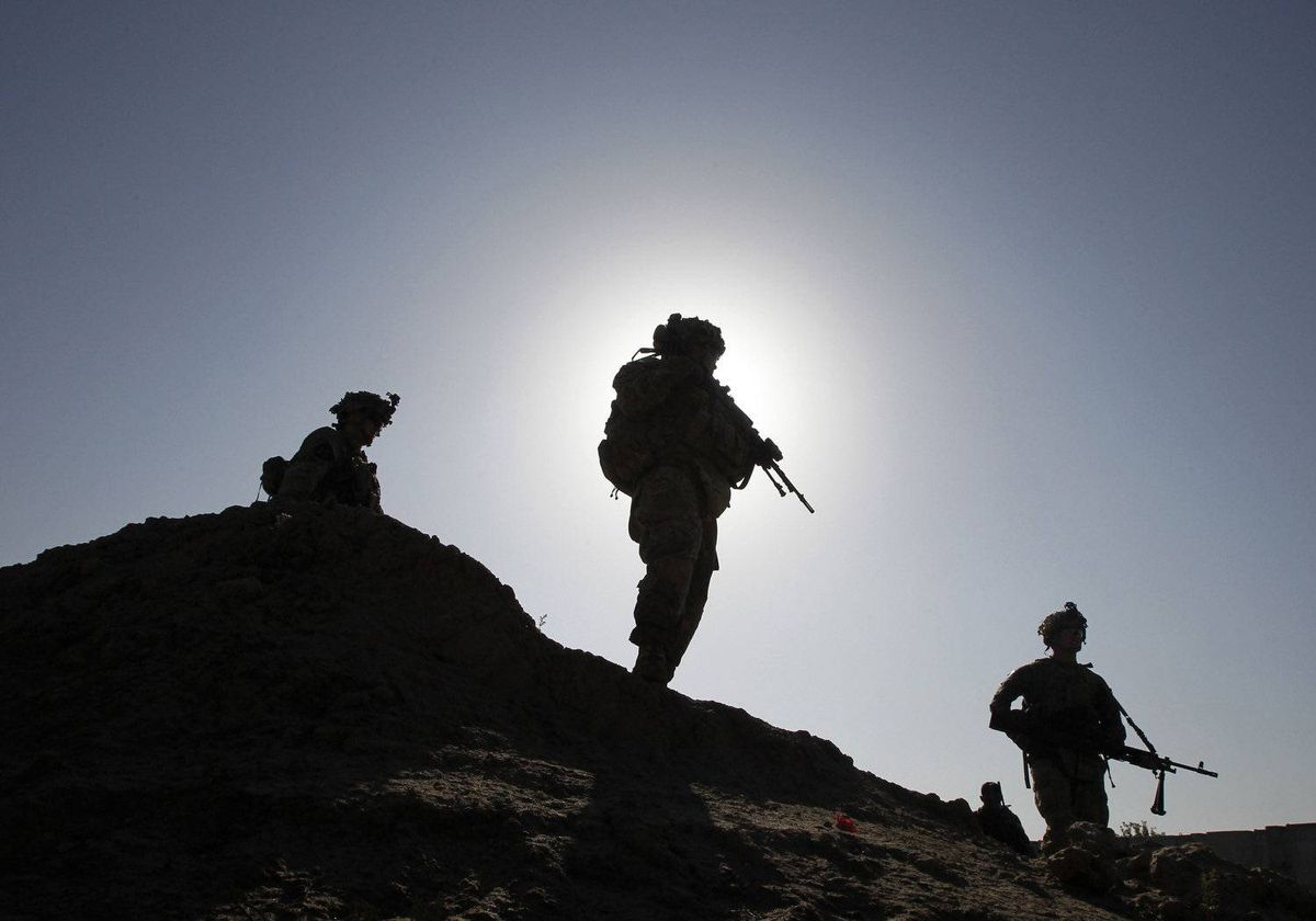 U.S. soldiers from 3rd platoon Bronco troop 5-20 infantry Regiment attached to 82nd Airborne patrol with Afghan national Army soldiers in Zharay district, Kandahar province, southern Afghanistan April 22, 2012.