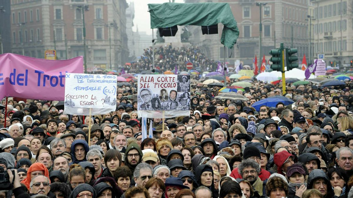 """Protesters gather during a demonstration called """"if not now, when?"""" organized by Italian women in protest at """"degrading"""" media coverage of the recent sex scandals surrounding Italian Prime Minister Silvio Berlusconi -- and attitudes to women in general on February 13, 2011 in Milan."""