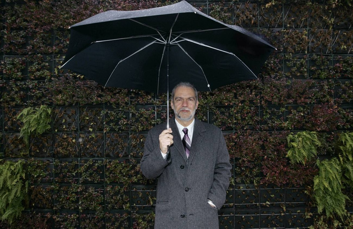 Thomas Mueller, president of the Canada Green Building Council, stands in front of a living wall at the LEED-certified Vancouver Aquarium. The freestanding wall is planted with spiny wood fern, licorice fern, evergreen huckleberry and wintergreen.