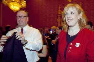Minister of Labour Lisa Raitt and an aide drop in on the festivities.