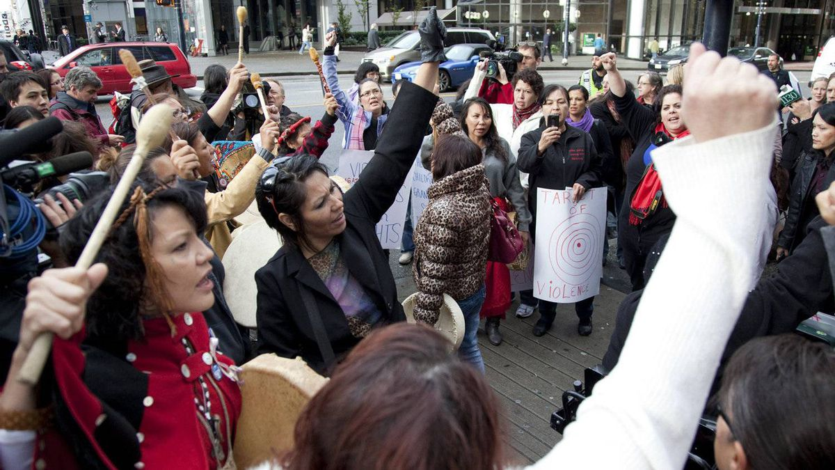 Women sing and chant outside of the missing women inquiry in downtown Vancouver, Tuesday, Oct. 11, 2011. Commissioner Wally Oppal has opened hearings to examine why police failed to stop Robert Pickton as he murdered impoverished sex workers from Vancouver's Downtown Eastside.