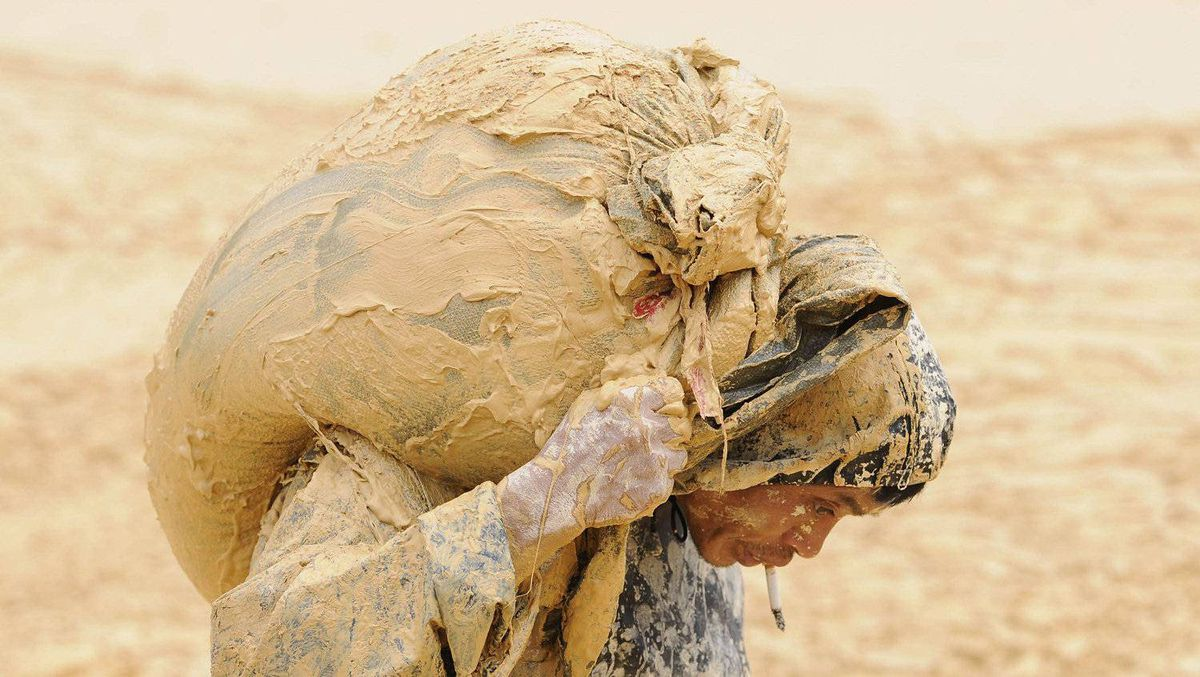 A man works at the site of a rare earth metals mine at Nancheng county, Jiangxi province, in this file photo taken October 20, 2010.
