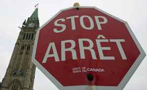 A government stop sign is seen near the Peace Tower in Ottawa on Wednesday, Dec. 30, 2009.