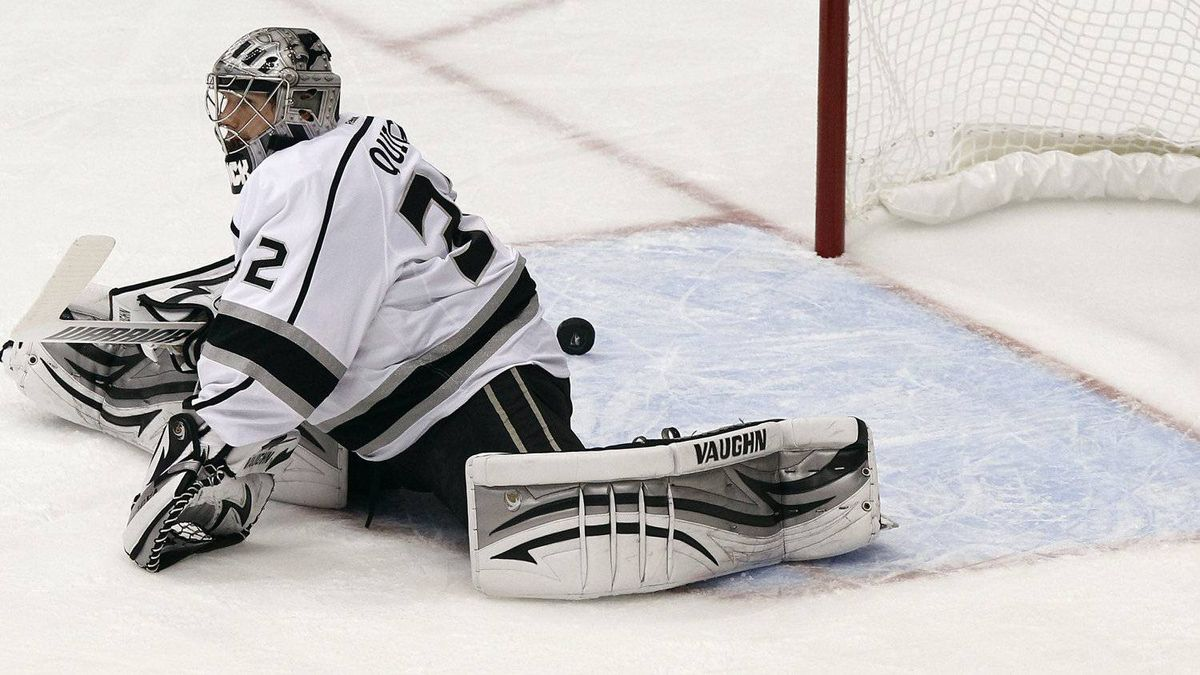 Los Angeles Kings' Jonathan Quick gives up a goal to Phoenix Coyotes' Derek Morris during the first period of Game 1 of the NHL hockey Stanley Cup Western Conference finals, Sunday, May 13, 2012, in Glendale, Ariz.(AP Photo/Ross D. Franklin)
