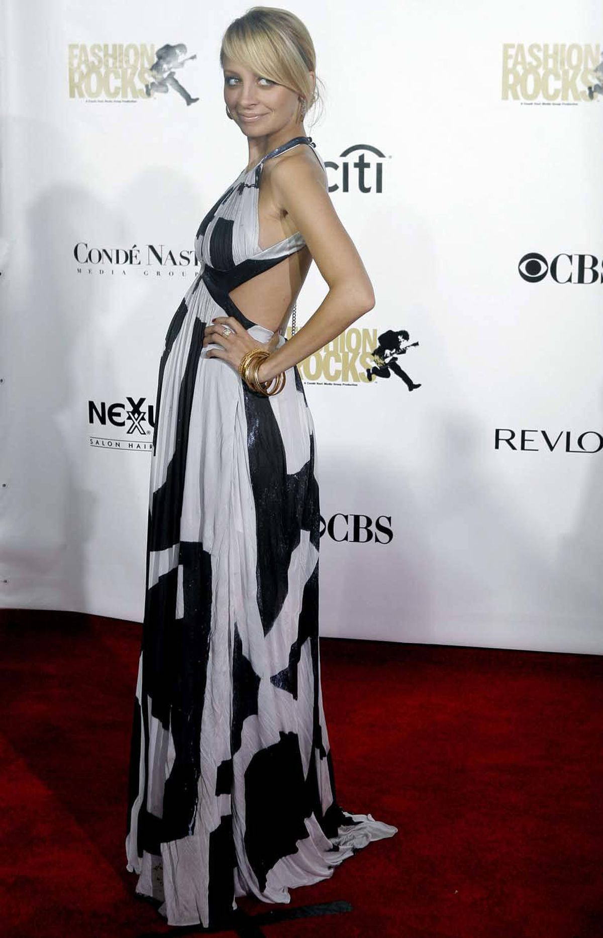 Soon enough, posing pregnant on the red carpet became common practice. Nicole Richie sticks out her bump at the 2007 Fashion Rocks Concert at Radio City Music Hall in New York on Sept. 6, 2007.