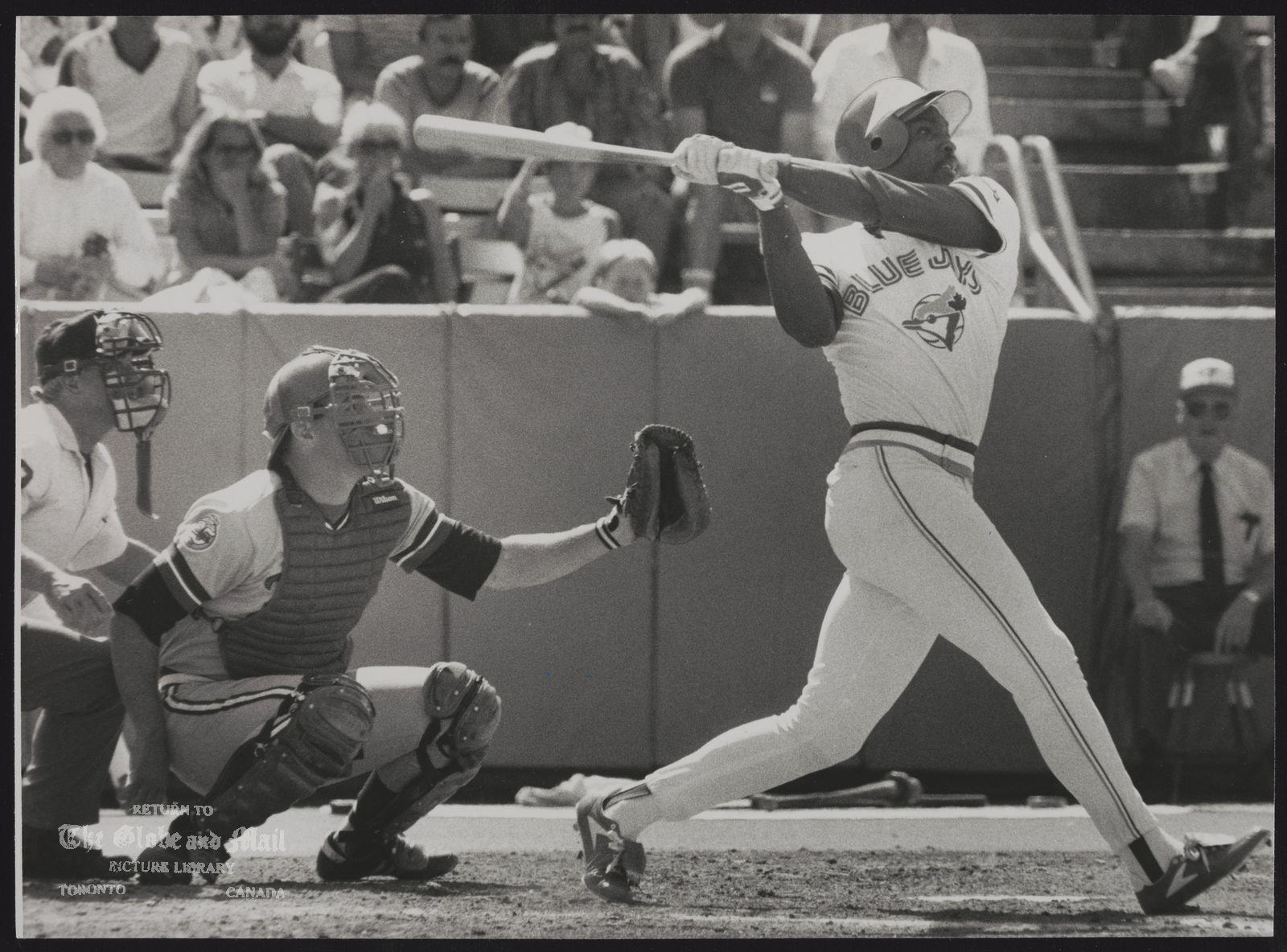 Lloyd MOSEBY Baseball Player Umpire Rich Garcia and Twin catcher Tim Laudner watch as Blue Jays' Lloyd Moseby strokes a third-inning grand slam.