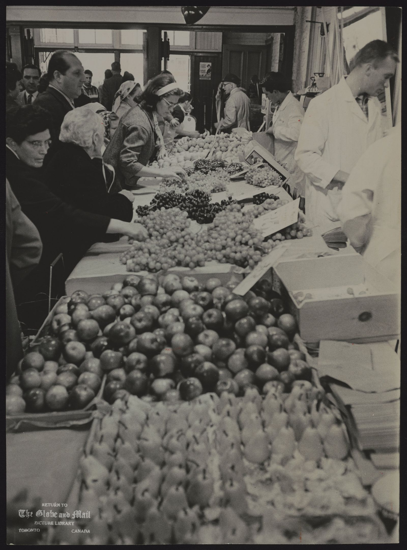 ST. LAWRENCE MARKET Pears, apples and varieties of grapes are spread out for sale Saturday for today's traditional feast. Shoppers at St. Lawrence Market found rich harvest.