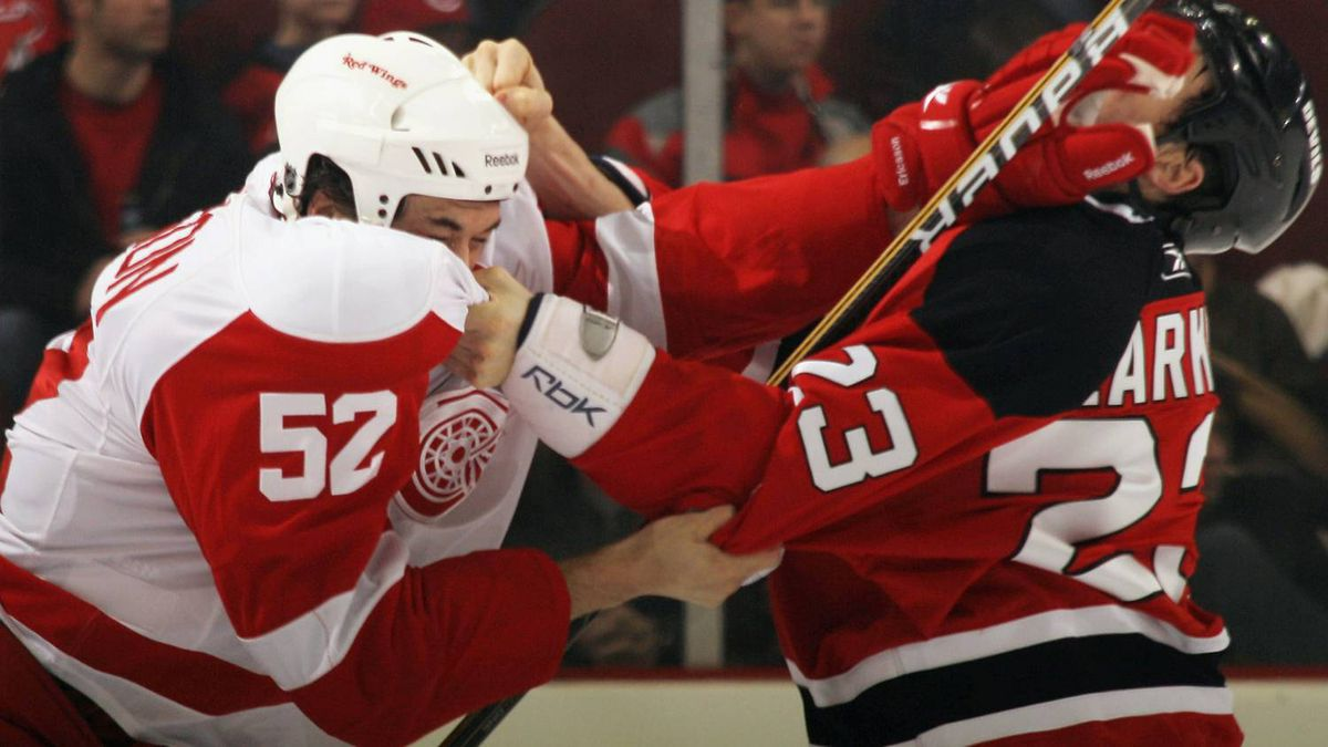 Jonathan Ericsson #52 of the Detroit Red Wings mixes it up with David Clarkson #23 of the New Jersey Devils at the Prudential Center on December 11, 2010 in Newark, New Jersey. The Red Wings won 4-1. (Photo by Bruce Bennett/Getty Images)