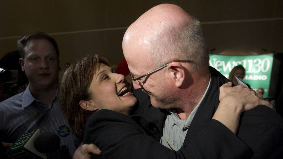 Premier designate Christy Clark is congratulated by MLA Pat Bell at a the B.C. Liberal Convention in Vancouver after she won the Liberal Leadership election Feb. 26, 2011.
