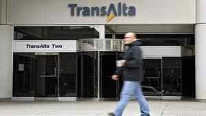 A pedestrian walks past the TransAlta building in downtown Calgary, Monday, Oct. 5, 2009.