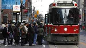 Customers board a TTC streetcar at Yonge and Queen Streets in Toronto on Nov. 28, 2011. Toronto Mayor Rob Ford announced the 2012 budget on Monday which includes a proposed 10-cent hike in TTC fares.