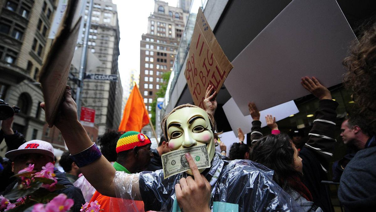 Occupy Wall Street members stage a protest march near Wall Street in New York. The Occupy Wall Street movement is having a hard time gaining traction because Middle America is not preoccupied with the rich, but more focused on giving thanks for what they have.
