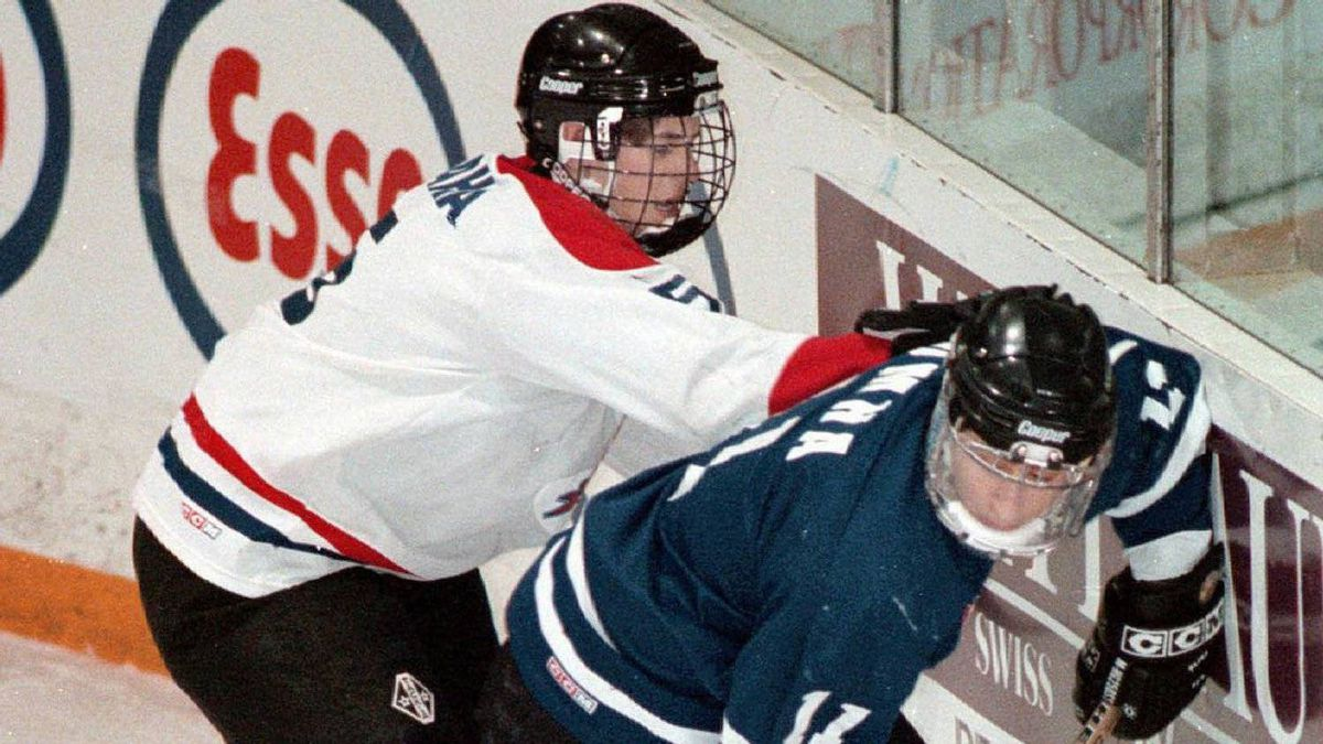 In this 1997 file photo, Thunder Bay Kings defenceman Brad MacLeod, left, checks Richmond Hill Stars Centre James Gideon during HFC Cup PeeWee Championship action in Welland Sunday. Richmond Hill won 12-3.