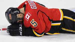 Calgary Flames' Mark Giordano lays on the ice injured during the first period of their NHL hockey game against the Nashville Predators in Calgary, Alberta, November 29, 2011. REUTERS/Todd Korol