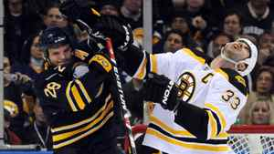 Buffalo Sabres center Paul Gaustad (L) collides with Boston Bruins defenseman Zdeno Chara in front of the Boston net during the first period of Game 5 of their NHL Eastern Conference quarter-finals hockey game in Buffalo, New York April 23, 2010. REUTERS/Gary Wiepert