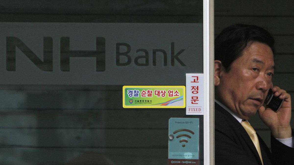 A man leaves a branch of agricultural banking cooperative Nonghyup in Seoul May 3, 2011. North Korean computer hackers were responsible for bringing down the network of the South Korean bank, Nonghyup, last month, prosecutors in Seoul said on Tuesday, in the latest of a string of cyber attacks thought to have originated from the secretive state.