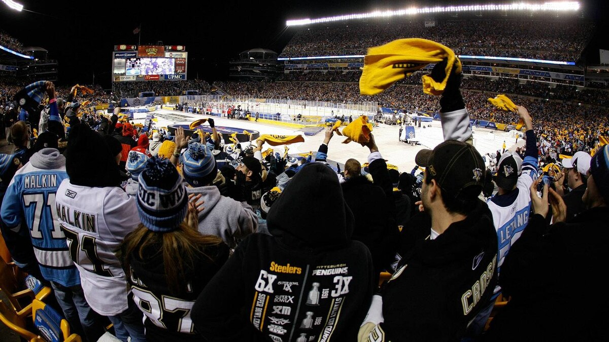 Fans of the Pittsburgh Penguins waves their 'terrible towels' as they cheer during the 2011 NHL Bridgestone Winter Classic against the Washington Capitals at Heinz Field on January 1, 2011 in Pittsburgh, Pennsylvania. (Photo by Justin K. Aller/Getty Images)