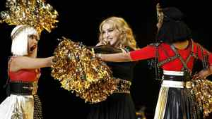Madonna performs during the halftime show with Nicki Minaj (L) and M.I.A. in the NFL Super Bowl XLVI football game in Indianapolis, Indiana, February 5, 2012.