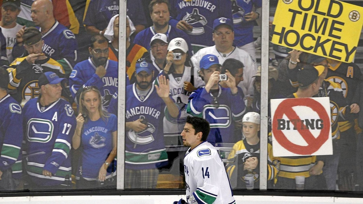 Vancouver Canucks Alex Burrows skates past fans during the warm-up before the first period of the NHL Final Game 3 between the Vancouver Canucks and Boston Bruins in Boston on June 6, 2011.
