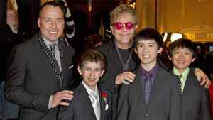 David Furnish and Sir Elton John pose with three of the boys who play the lead role in Billy Elliot: Myles Erlick, Marcus Pei and J.P. Viernes.