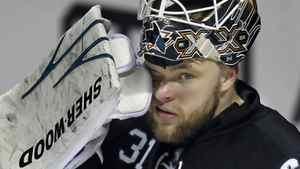San Jose Sharks goalie Antti Niemi wipes his eye during a break. REUTERS/Mike Blake